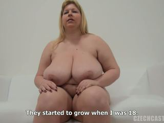 Big beautiful woman strips and reveals her huge bosom