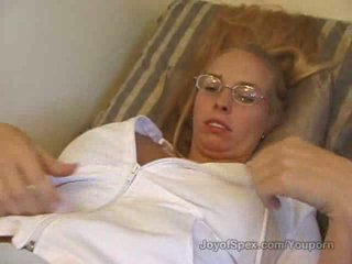 Brittney in glasses plays with her big tits