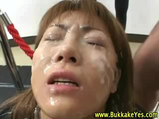 Bukkake oriental slut drenched in and drinking jizz