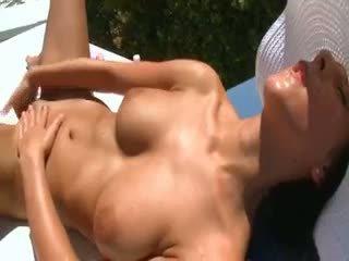 Busty Woman Masturbating On The Sunbed