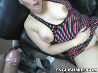 Short haired UK MILF blows big prick on the sofa