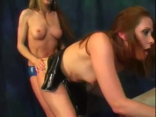 Alexandra Silk and her hot ass friend enjoy a bit of strap on cock action