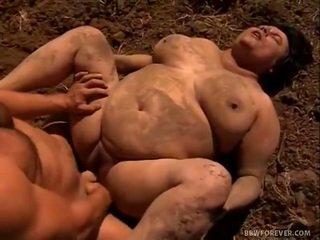 Farmer stretches mud filled שמנמן