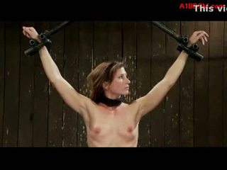 Brunette girl getting tied up whipped by master and mistress