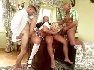 Naughty blonde riding three cocks