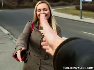 Busty tanned blonde gives meaty cock a blowjob in public