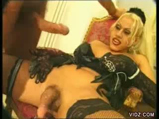 Blondie shemale showered with cum