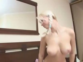 Pigtailed blondie playing with boobs