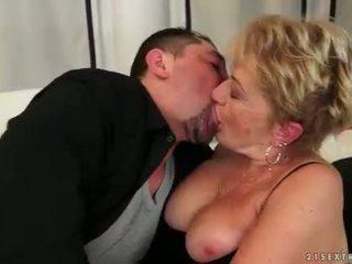 Busty granny gets fucked on sofa