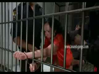Gagged brunette inmate gets her butt aggressively fucked by a bunch of horny officers