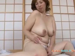 Milf With a Hairy Pussy Fingering Herself Using a Vibrator